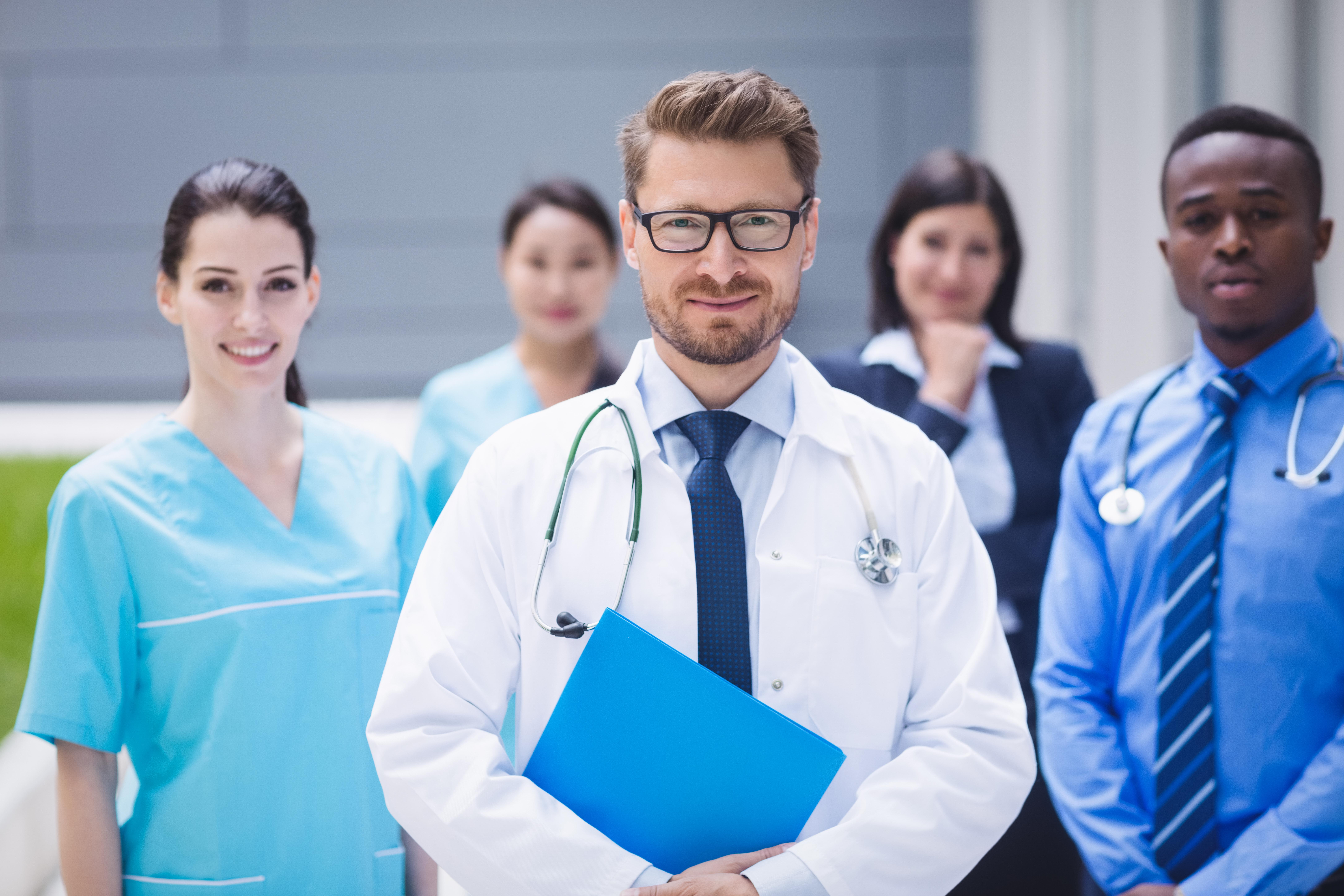 Motifworks-Team of doctors standing together hospital premises